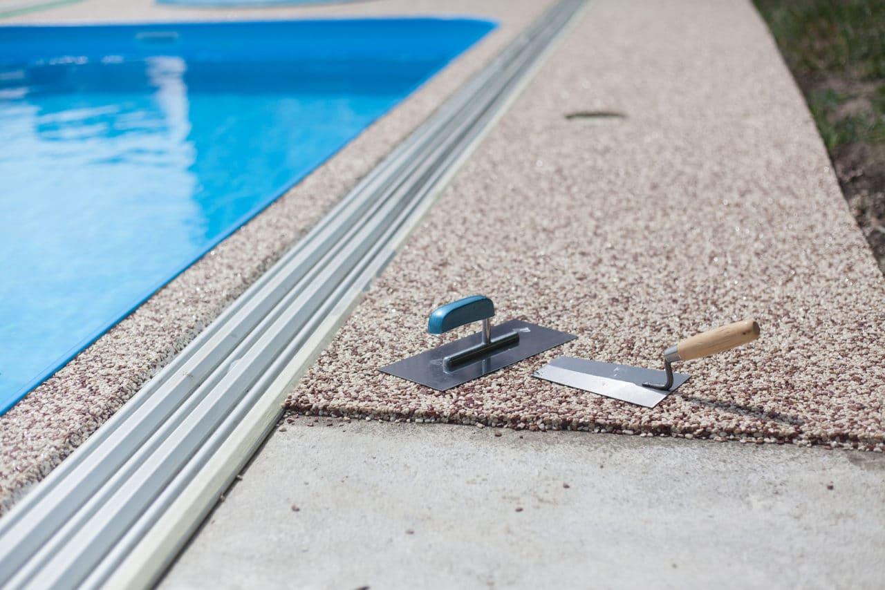 Steinteppich als Umrandung für Pools